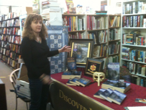 This is Tonya Macalino demonstrating how to set up an author's table for book signings and fairs.