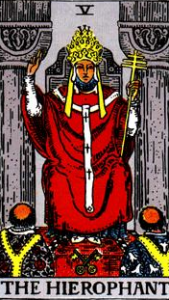 The Hierophant, sitting between those same two pillars and speaking to two different/opposing clergymen. This card actually shows two triads.