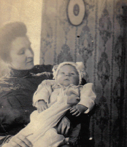Grandma, holding my father